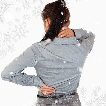 portrait of the painful back of a businesswoman against snowflakes