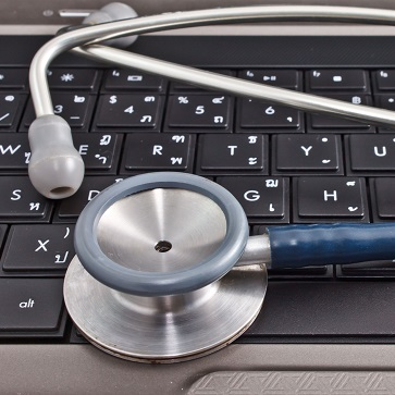 laptop computer and stethoscope